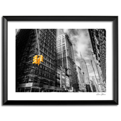 Black and white print with yellow street light looking up 5th Avenue toward the Empire State Building